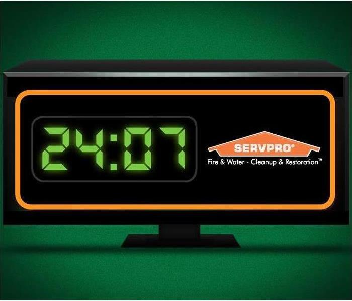 Digital clock displaying 24:07 with SERVPRO logo displayed on the clock